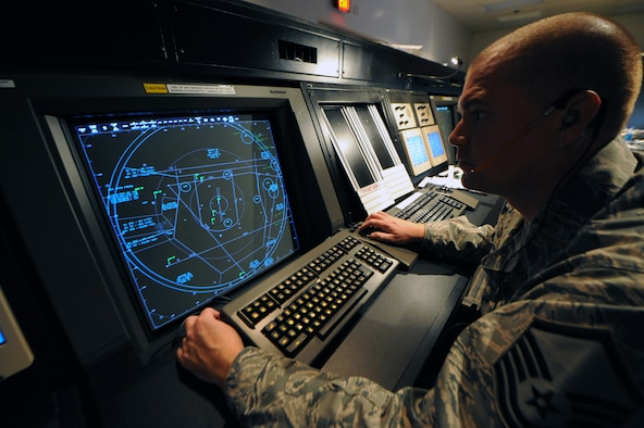 WHITEMAN AIR FORCE BASE, Mo., -- Master Sgt. Lowell Morris, 509th Operations Support Squadron, guides aircraft through Whiteman's airspace.  While deployed, Sergeant Morris coordinated airspace used for combat operations.  (U.S. Air Force photo/Staff Sgt. Jason Huddleston) (Released)