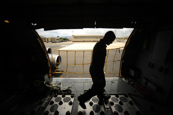 JOINT BASE PEARL HARBOR HICKAM, HAWAII (July 10, 2010) U.S. Air Force Capt. Clayton Adams, a KC-135 Stratotanker pilot with the 465th Air Refueling Squadron, Tinker AFB, Okla., conducts an aircraft inspection prior to a sortie in support of Rim of the Pacific (RIMPAC) 2010. RIMPAC includes more than 14 nations, 32 ships, five submarines, more than 170 aircraft and more than 20,000 Soldiers, Sailors, Marines and Airmen. RIMPAC enhances cooperation between partnering nations and practices our ability to plan, communicate, and execute operations. (U.S. Air Force photo by Tech. Sgt. Jacob N. Bailey/Released)