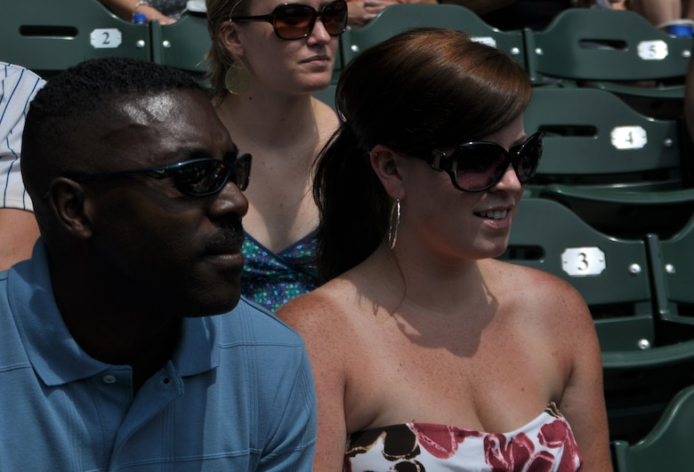 Senior Master Sgt. Marlin Mosley, an instructor boom operator for the 128th Air Refueling Wing, Milwaukee, and his wife, Jessica Mosley, watch a slideshow depicting Marlin's recent military accomplishments at Miller Park, Milwaukee, on Sunday, July 11, 2010.  Sergeant Mosley, joined by family and friends, was honored during the pre-game events of the Brewers' Sunday game against the Pittsburg Pirates.