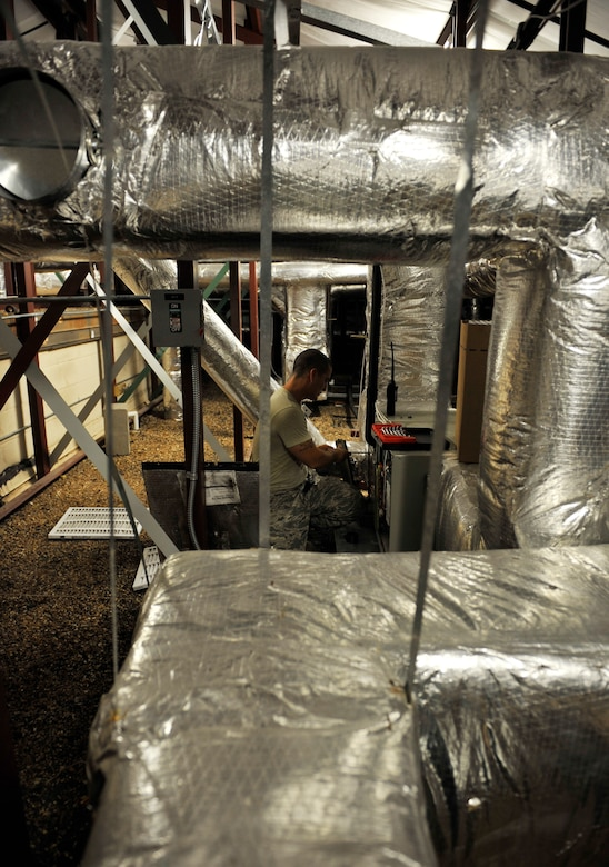 MOODY AIR FORCE BASE, Ga.-- Senior Airman Steven Kindle, 23rd Civil Engineer Squadron heating, ventilation, air conditioning and refrigeration journeyman, performs routine maintenance in the attic of the Jason D. Cunningham Airman Leadership School here July 7. The HVAC/R shop performs recurring maintenance to every HVAC system on base, completing large-scale work orders where they either install brand new systems or completely replace an existing one. (U.S. Air Force photo by Staff Sgt. Schelli Jones/RELEASED)