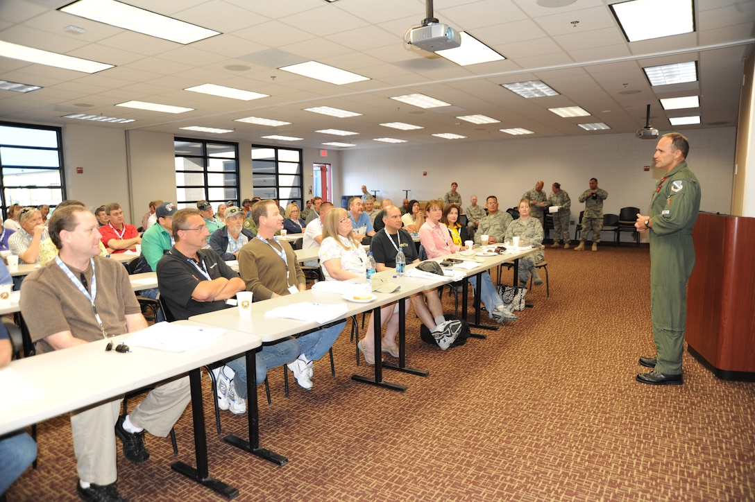 Brig Gen Trulan A. Eyre, 140th Wing Commander, speaks to employers of Colorado Air National Traditional Guardsmen.  Citizen-Airmen of the Colorado Air National Guard showcased 140th Wing capabilities to their employers at Buckley AFB, Colo. July 10. This day was part of the Employers Support of the Guard and Reserve program.