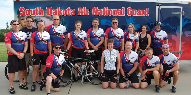 SIOUX FALLS, S.D. - Members of the South Dakota Air National Guard Tour de Kota team were; (standing left to right) Kevin Miller, Marcus Brandenburg, Jake Lackas, Jeff Denotter, Ariel Keating, Tim Wenzel, Russ Walz, Carey Haugen, Liz Johnson, Bruce Lee, (kneeling left to right) Brian Voges, Gail Punt, Al Punt, Troy Erlandson, and Mike Haugen. (Photographer unknown - released)