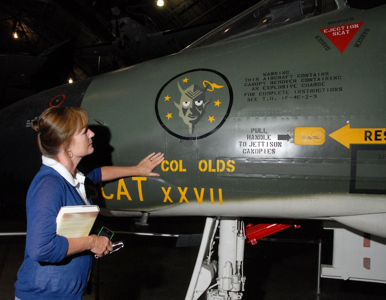 DAYTON, Ohio -- Christina Olds, daughter of the late triple ace and Air Force Cross recipient Brig. Gen. Robin Olds, touches her father's F-4C Phantom II at the National Museum of the U.S. Air Force. (U.S. Air Force Photo)
