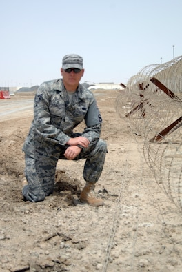 Staff Sgt. Tommy Dailey, security forces craftsman with the 380th Expeditionary Security Forces Squadron, poses near the perimeter of this nondisclosed base in Southwest Asia on July 14, 2010. (U.S. Air Force Photo/Staff Sgt. Jeremy Larlee/released)