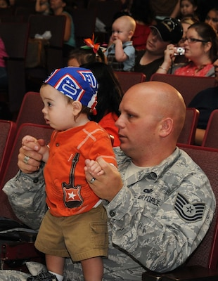 Tech. Sgt. Nathan Rohdert, 343rd Training Squadron, and his son Cage watch the Sesame Street/USO Experience for Military Families July 8 at the Bob Hope Performing Arts Center. (U.S. Air Force photo/Alan Boedeker)
