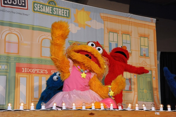 Zoe dances during the Sesame Street Experience July 8. The USO sponsored four permances of the show which addressed difficult issues faced by military families. (U.S. Air Force photo/Alan Boedeker)