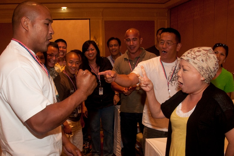 Rock beats Scissors as Staff Sgt. Steve Dumlao and Lee Miyamoto, wife of Master Sgt. Roy Miyamoto, face off in a social exercise held during a Yellow Ribbon event held at the Ritz-Carlton, Kapalua, Maui, in June. The event was for 624th Civil Engineer Squadron Reservists, who recently returned from deployment in Afghanistan in support of Operation Enduring Freedom, and their family members as a part of their re-integration process back home. (U.S. Air Force photo/Master Sgt. Daniel Nathaniel)