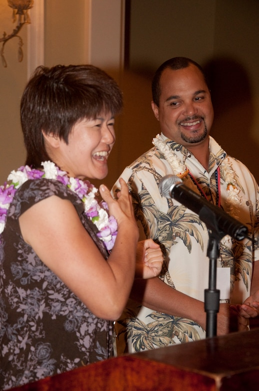 Guest speakers retired-Master Sgt. Keoni Littlejohn and his wife Erin discuss their own challenges as a couple, when a military member deploys, at a Yellow Ribbon event held at the Ritz-Carlton, Kapalua, Maui, in June. The event was for 624th Civil Engineer Squadron Reservists, who recently returned from deployment in Afghanistan in support of Operation Enduring Freedom, and their family members as a part of their re-integration process back home. (U.S. Air Force photo/Master Sgt. Daniel Nathaniel)
