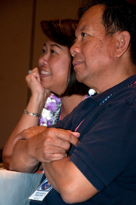 Senior Master Sgt. Rolando Belong and his wife Arsenia listen to various briefers inform them of their various rights and responsibilities at a Yellow Ribbon event held at the Ritz-Carlton, Kapalua, Maui, in June. Sergeant Belong was one of many 624th Civil Engineer Squadron Reservists who recently returned from deployment in Afghanistan in support of Operation Enduring Freedom. Aresenia Belong was one of two key spouses who helped hold down the home front for the families. (U.S. Air Force photo/Master Sgt. Daniel Nathaniel)