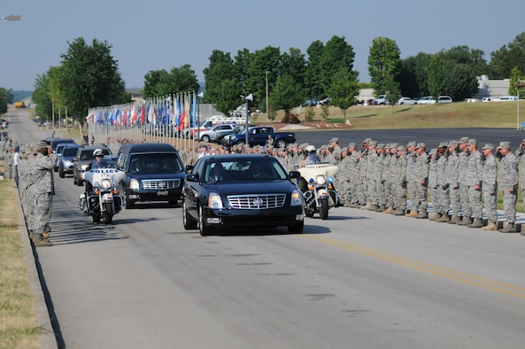 McGHEE TYSON AIR NATIONAL GUARD BASE, Tenn. - The staff and students of The I.G. Brown Air National Guard Training and Education Center join an honor cordon on Briscoe Drive here to pay tribute to a fallen soldier, July 7, 2010. Army Pfc. Robert K. L. Repkie, 20, of Knoxville, died June 24 at Forward Operating Base Farah, Afghanistan. (U.S. Air Force photo by Master Sgt. Kurt Skoglund/Released)