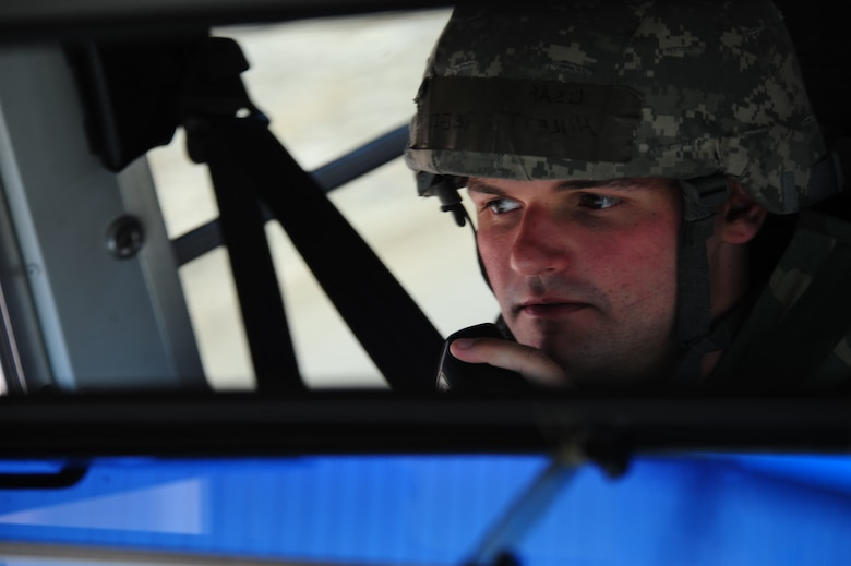 ELLSWORTH AIR FORCE BASE, S.D. – Airman 1st Class Gregory Hulett, 28th Logistics Readiness Squadron vehicle operator, updates his status on a radio during a phase II operational readiness exercise, July 20. The exercise provides training and prepares Airmen for worldwide deployments.  (U.S. Air Force photo/Airman 1st Class Corey Hook)