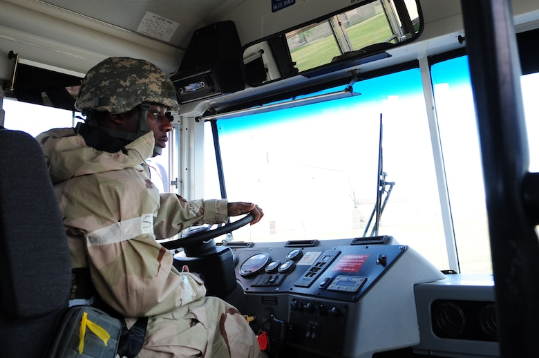 ELLSWORTH AIR FORCE BASE, S.D. – Airman Herb Shaw, 28th Logistics Readiness Squadron vehicle operator, drives a bus during the phase II operational readiness exercise, July 20. The ORE is designed to test Airmen across the base on their ability to operate in a deployed environment.  (U.S. Air Force photo/Airman 1st Class Corey Hook)