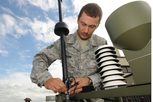 WHITEMAN AIR FORCE BASE, Mo. - Staff Sgt. Charles Malone, 509th Operation Support Squadron weather forecaster, readies a surveying instrument as part of the Tactical Meteorological System Observing station, July 6. The TMOS systems can be set up and sending data in 15 minutes. (U.S. Air Force photo by Senior Airman Carlin Leslie)(Released)