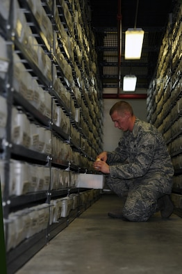 WHITEMAN AIR FORCE BASE, Mo., -- Airman 1st Class Ben Smyser, 509th Logistic Readiness Squadron Aircraft Part Store technician, fills a maintenance order that is needed for an aircraft on July 14. (U.S. Air Force photo/Staff Sgt. Jason Huddleston) (Released)