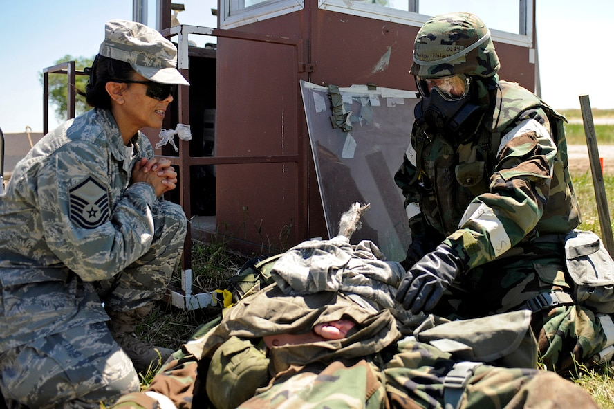 ELLSWORTH AIR FORCE BASE, S.D. – (Left) Master Sgt. Dianne Ramirez, 28th Medical Operations Squadron superintendant, overlooks self-aid buddy care provided to an exercise victim by Senior Airman Matthew Halvorson, 28th Civil Engineer Squadron structures journeyman, during a phase II operational readiness exercise, July 20. The phase II ORE is designed to test Airmen on operational readiness during a simulated deployment. (U.S. Air Force photo/Airman 1st Class Matthew Flynn)