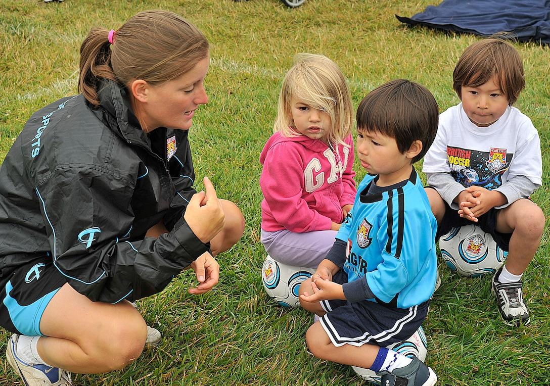 VANDNEBERG AIR FORCE BASE, Calif.--European coach Fern Burrage with Challenge Sports, explains to the children  how to play the game Alien Attack during soccer camp here, Tuesday July 20, 2010. The coaches use games such as Alien Attack and Spongebob to keep the children interested in learning the basic skills.  (U.S. Air Force Photo/Senior Airman Stephanie Longoria)