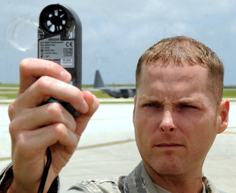 ANDERSEN AIR FORCE BASE, Guam - Staff Sgt. William Robinson, 36th Operations Support Squadron weather forecaster, checks wind speed, temperature and other weather conditions July 7. The 36th OSS weather flight provides weather products and knowledge to expeditionary flying squadrons, wing staff, transient aircrews and flight line operations. They ensure the local populace has the information they need to react to any weather conditions. (U.S. Air Force photo/ Airman 1st Class Anthony Jennings)