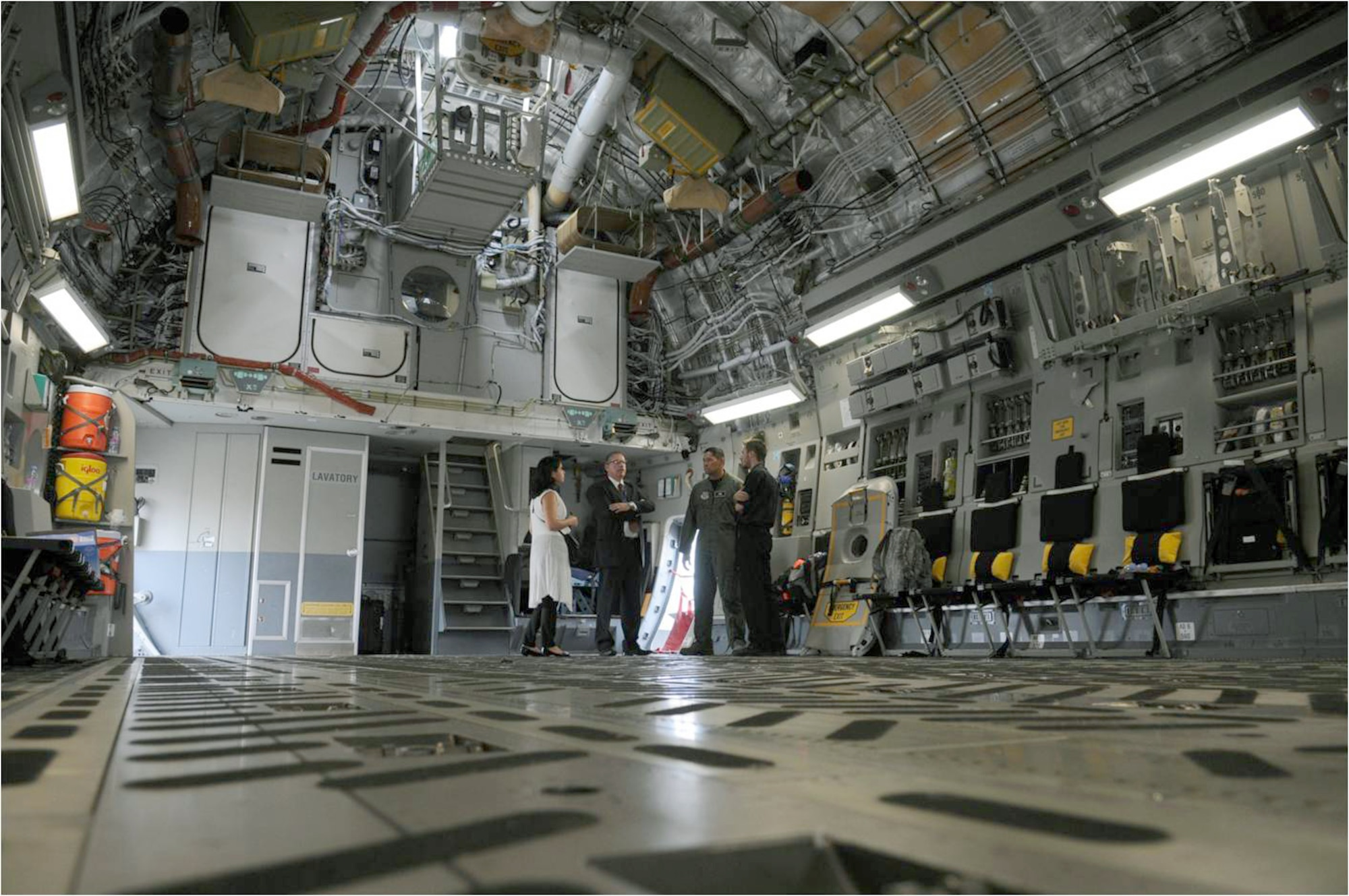 Spectators tour the cargo bay of a C-17 Globemaster III from Travis Air Force Base, Calif., July 20, 2010, in Farnborough, England. Eleven U.S. military aircraft and approximately 70 personnel representing all branches of service participate in the 2010 Farnborough International Air Show. (U.S. Air Force photo/Staff Sgt. Jerry Fleshman)