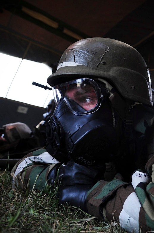 ELLSWORTH AIR FORCE BASE, S.D. – Airman 1st Class John Henry, 28th Medical Operations Squadron ambulance services technician, waits out a simulated chemical attack while in mission-oriented protective posture gear during a phase II operational readiness exercise, July 21. A phase II ORE is designed to prepare Airmen for deployed operations, including potential chemical attacks. (U.S. Air Force photo/Airman 1st Class Corey Hook)