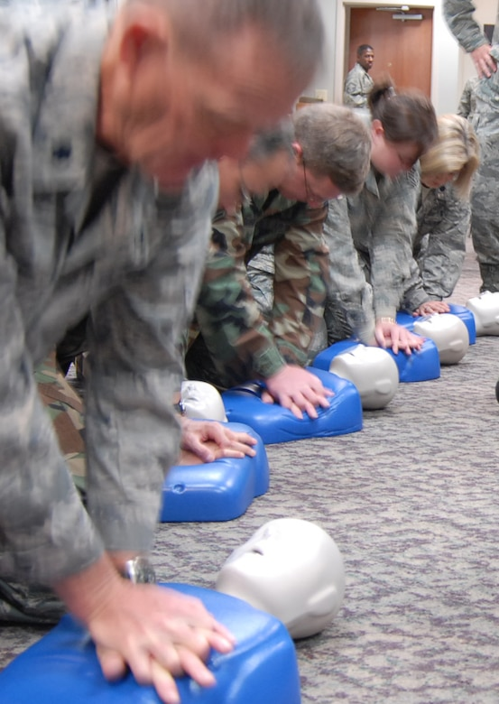 Missouri Air National Guard members get Cardiopulmonary Resuscitation (CPR) training during a recent unit training assembly drill at Scott Air Force Base. Courses like self-aid and buddy care help Airmen survive alone, or take care of others injured during deployment. SABC also prepares them to take care of someone in the community like friends, family and co-workers. (U.S. Air Force photo/Maj. Stan Paregien)