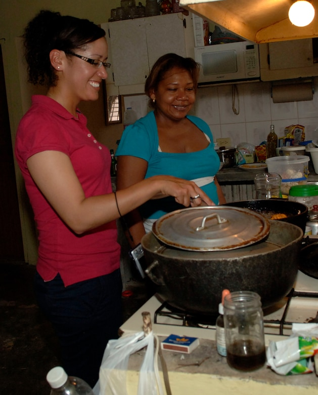 Senior Airman Sheryl Job (left) makes lunch with her Aunt Delia Sepulveda, June 11, in Felippio, Panama. The 25-year-old Panamanian native deployed from the 119th Wing in Fargo, N.D., to support New Horizons Panama 2010, and she was able to visit members of her family whom she had been separated from for 18 years.