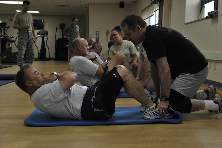 Senior leadership from the Montana Air National Guard perform the sit-up portion of the Air Force Fitness Test on July 11, 2010. (U.S. Air Force photo by Staff Sgt. John Turner)