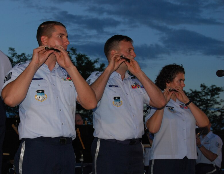 Tech. Sgts. John Dawson and Ryan Janus and Master Sgt. Sandra Tiemens perform on tin whistles during the Air Force Academy Band's performance in Castle Rock, Colo., July 21, 2010. The free concert drew about 1,100 residents from the town, which is about 30 miles north of the Air Force Academy in Colorado Springs. (U.S. Air Force photo/Staff Sgt. Don Branum)