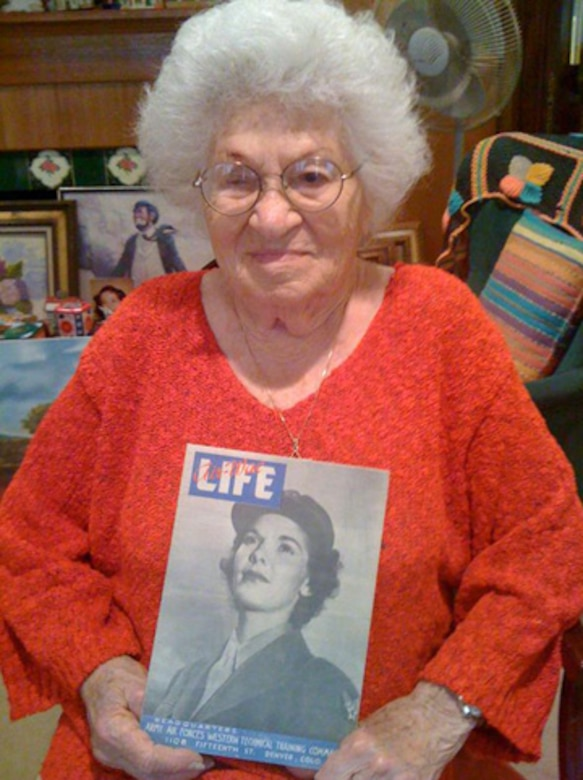 """Bea Cohen, 100, holds a copy of """"Life Magazine"""" from the 1940's. While not a photo of her, the photo story inside depicts the life of women in the military during WW II.  (Photo by Lt. Mara Title)"""