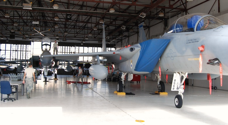 An F-15D (front) is parked in a training hangar at Sheppard Air Force Base, Texas, July 23 to be used for training F-15 aircraft maintenance students on the latest equipment and controls of an F-15 jet. Sheppard acquired a total of 13 F-15s which were converted into trainers to update F-15 maintenance courses that used F-15A and F-15B models, which do not match the models currently used on operational flightlines.  The newer-model aircraft is awaiting the arrival of technical orders before it can be used to instruct students.  (U.S. Air Force photo/Tech. Sgt. Vernon Cunningham)