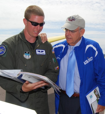 Cadet 2nd Class Russell Ahrens of Cadet Squadron 06 reviews a glider safety checklist with Robin Hayes during the Board of Visitors' tour of the Air Force Academy Airfield July 24, 2010. Mr. Hayes is a former North Carolina congressman and a current member of the BOV. Cadet Ahrens is an instructor pilot for the soaring program. (U.S. Air Force photo/Staff Sgt. Don Branum)
