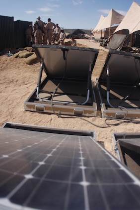 MARINE CORPS AIR GROUND COMBAT CENTER TWENTYNINE PALMS, Calif. – Solar panels soak up rays and convert it to electricity at Combat Center Range 220 July 26. The panels are being utilized by 3rd Battalion, 5th Marine Regiment, based out of Marine Corps Base Camp Pendleton, Calif., to power radios, laptop computers, lighting, ventilation and other systems.