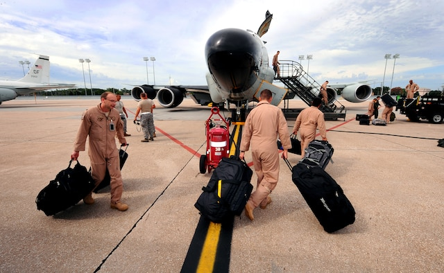 OFFUTT AIR FORCE BASE, Neb. - Airmen assigned to the 45th Reconnaissance Squadron, prepare to leave on an RC-135 aircraft for a deployment. The 45th RS supports four mission platforms which involve strategic electronic reconnaissance, ballistic missile detection, nuclear debris detection and treaty verification. Squadron members must be ready to deploy at a moment's notice. U.S. Air Force photo by Josh Plueger
