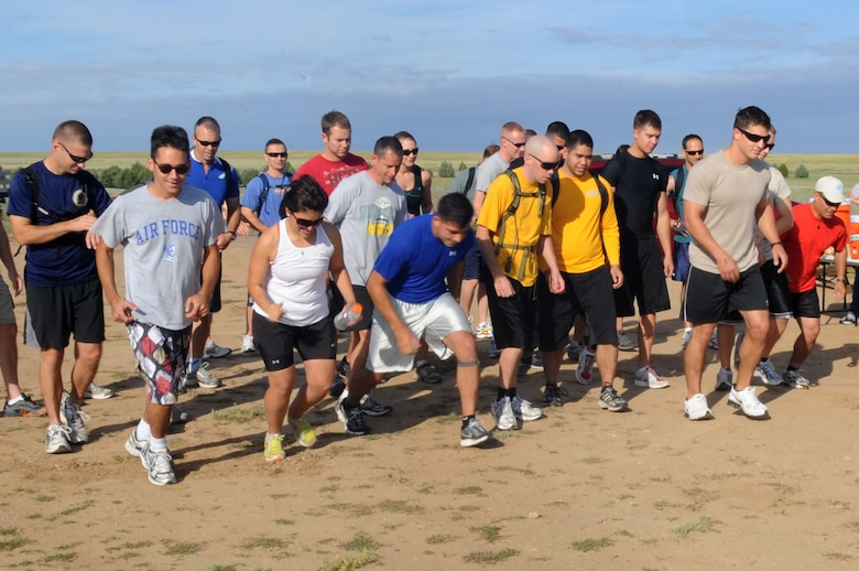 BUCKLEY AIR FORCE BASE, Colo.-- Members of Team Buckley compete against each other in teams of two during the Adventureman Race July 24. The race consisted of different obstacles and challenges while completing a 15-mile run. (U.S. Air Force Photo by Airman 1st Class Manisha Vasquez)