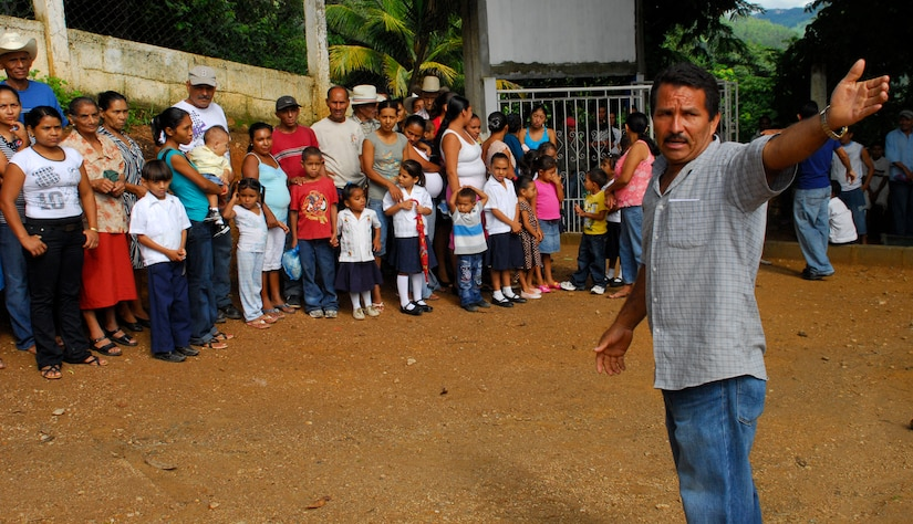 EL ROBLITO, Honduras --  As Joint Task Force-Bravo members prepare bags of supplies, Ruiz Santos, the community leader here, explains the process of receiving the goods to the villagers here July 16 during the Chapel Hike. The Soto Cano Air Base Friendship Chapel sponsors monthly hiking trips that partners JTF-Bravo members with local community leaders, city hall officials and the World Food Program to provide support to surrounding villages in need of food and supplies. (U.S. Air Force photo/Tech. Sgt. Benjamin Rojek)