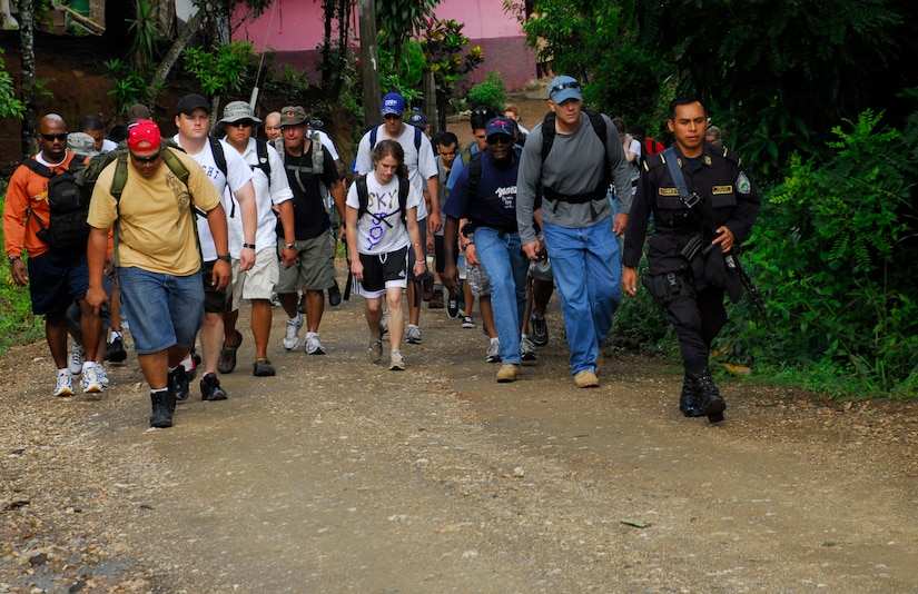 EL ROBLITO, Honduras --  After leaving the buses parked near a highway, members of Joint Task Force-Bravo hike up to this mountain village to deliver food, clothes and other supplies during a Chapel Hike here July 16. More than 50 JTF-Bravo members volunteered to trek up the mountain road to Escuela Juan Lindo to bring supplies to the villagers here. (U.S. Air Force photo/Tech. Sgt. Benjamin Rojek)
