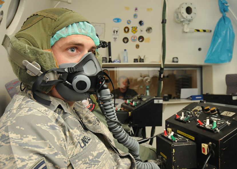 SOESTERBERG AIR BASE, Netherlands – Staff Sgt. Kevin Lindsey, 701st Munitions Support Squadron satellite communications command and control crew chief, listens to instructions in the altitude chamber during training June 24. The purpose of the training was to help new aircrew members recognize the symptoms they may feel when in a low-oxygen environment. (U.S. Air Force photo/Staff Sgt. Benjamin Wilson)