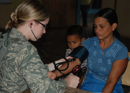 DUYURE, Honduras -- Air Force 1st Lt. Nicole Musshorn, a registered nurse in Joint Task Force-Bravo's Medical Element, takes a Honduran woman's blood pressure during a Medical Civic Assistance Program here July 20. During the MEDCAP, a team of Honduran health care providers and JTF-Bravo personnel provided medical care to 435 Duyure residents in need. (U.S. Air Force photo by 1st Lt. Jen Richard)
