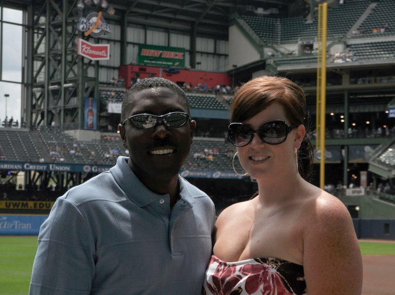 Senior Master Sgt. Marlin Mosley, an instructor boom operator for the 128th Air Refueling Wing, Milwaukee, and his wife, Jessica Mosley, stand near the ball field at Miller Park, Milwaukee, on Sunday, July 11, 2010. Sergeant Mosley was recognized during the pre-game of the Brewers' Sunday match for his continuing service to the nation and for his excellent performance during recent deployments.