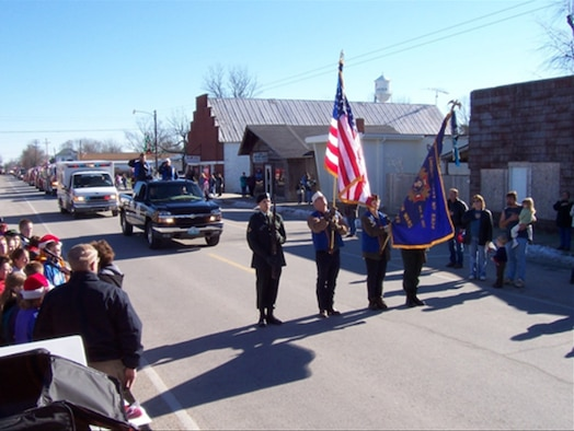 "LINCOLN, Mo. - Members of the Veterans of Foreign Wars 2591 march in the community parade. Lincoln is a small community near Highway 65, just north of Lake of the Ozarks and Truman Reservoir.  Located in Benton County, it could easily be described as ""The Front Door to the Twin Lakes Area of Lake of the Ozarks and Truman Lake""."