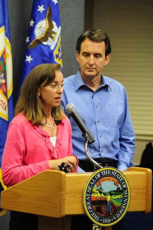 Minnesota Governor Tim Pawlenty and First Lady Mary Pawlenty speak to military members, family and community leaders at the 148th Fighter Wing Air National Guard Base in Duluth, Minn. July 28, 2010. Governor Pawlenty and the First Lady arrived at the 148th to announce that the First Lady's Military Family Care Initiative will continue and expand to provide additional assistance to military families under the National Guard's Beyond the Yellow Ribbon Program. (Air National Guard photo by Tech. Sgt. Amie M. Dahl)