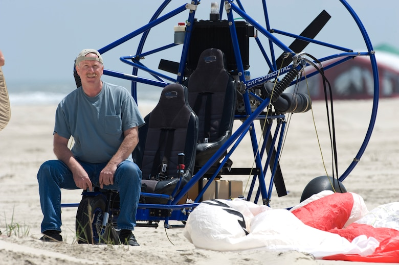 A Narrow Escape - Powered parachutist Ken Harger, 55, barely escaped with his life when his aircraft crashed into the Gulf of Mexico, trapping him under water for more than five minutes. He still flies his contraption, but says he is no longer quite as daring as he'd been before the mishap. (photo by Tech. Sgt. Samuel Bendet)