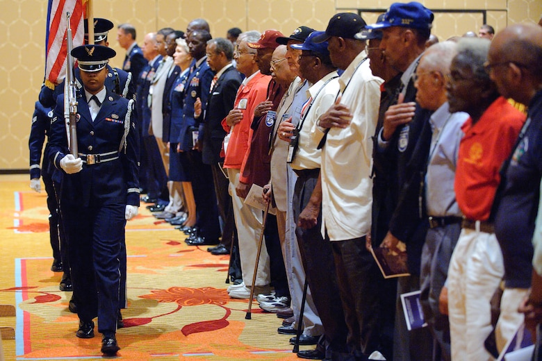 Members of the Randolph Honor Guard post the colors at the beginning of the 39th Tuskegee Airmen convention, held in downtown San Antonio, Texas.  Tuskegee Airmen honor the flag prior to the Lonely Eagles Ceremony July 29.  The ceremony recognizes Tuskegee Airmen who died during the past year. (U.S. Air Force photo/Steve Thurow)