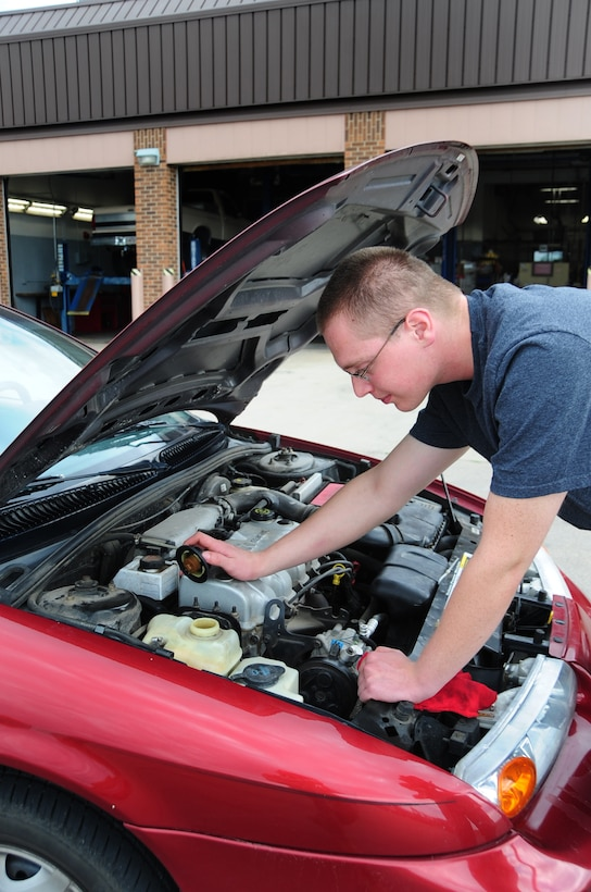 ELLSWORTH AIR FORCE BASE, S.D. -- Airman 1st Class Joshua Dunn, 28th Logistics Readiness Squadron vehicle maintainer, checks the engine coolant in his car, July 28.  The coolant keeps the engine from over-heating and potentially ruining the engine entirely. (U.S. Air Force photo/Airman 1st Class Anthony Sanchelli)