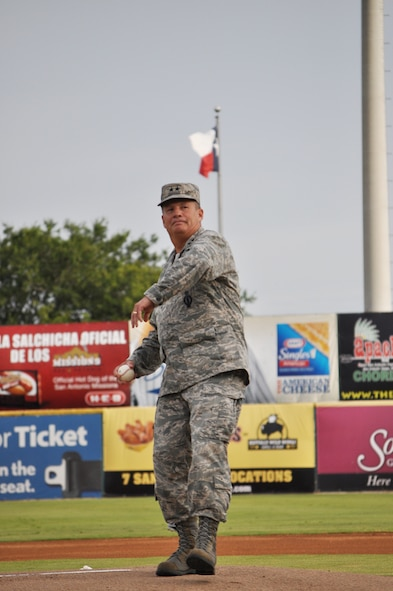 Maj. Gen. Richard E. Webber, 24th Air Force commander, Lackland Air Force Base, Texas throws out the first pitch at the San Antonio Missions baseball game July 28 against the Corpus Christi Hooks in Wolff Stadium. The Hooks won the game 6-2. Members of 24th AF enjoyed for a picnic prior to the game sponsored by the booster club.(US Air Force photo by Capt. Christine Millette)