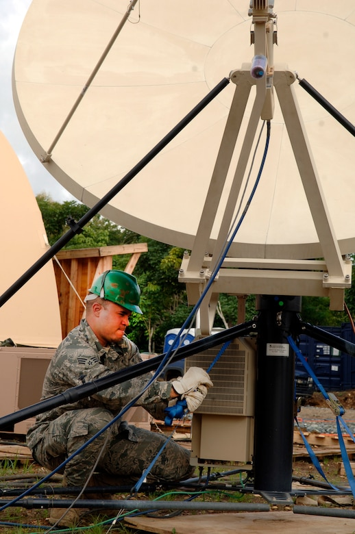 Senior Airman Cesar Morales, deployed from the 32nd Combat Communications Squadron, secures the base of the satellite array during New Horizons Panama 2010. (U.S. Air Force photo/Tech. Sgt. Eric Petosky)