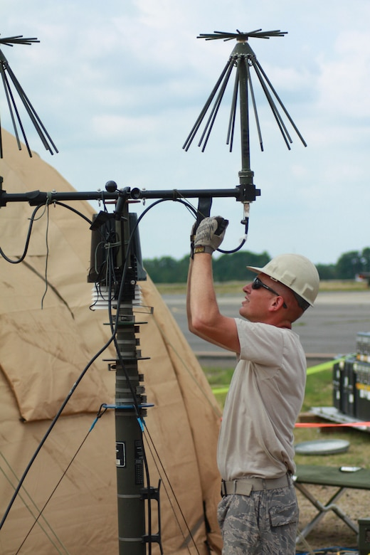 TSgt Philip Seif from the Kentucky Air National Guard's 123rd Contingency Response Group based out of Louisville, Ky.,  assembles a communications antenna at Lakehurst Air Field at McGuire Air Force Base after arriving to provide humanitarian assistance as part of a joint exercise on July 28.