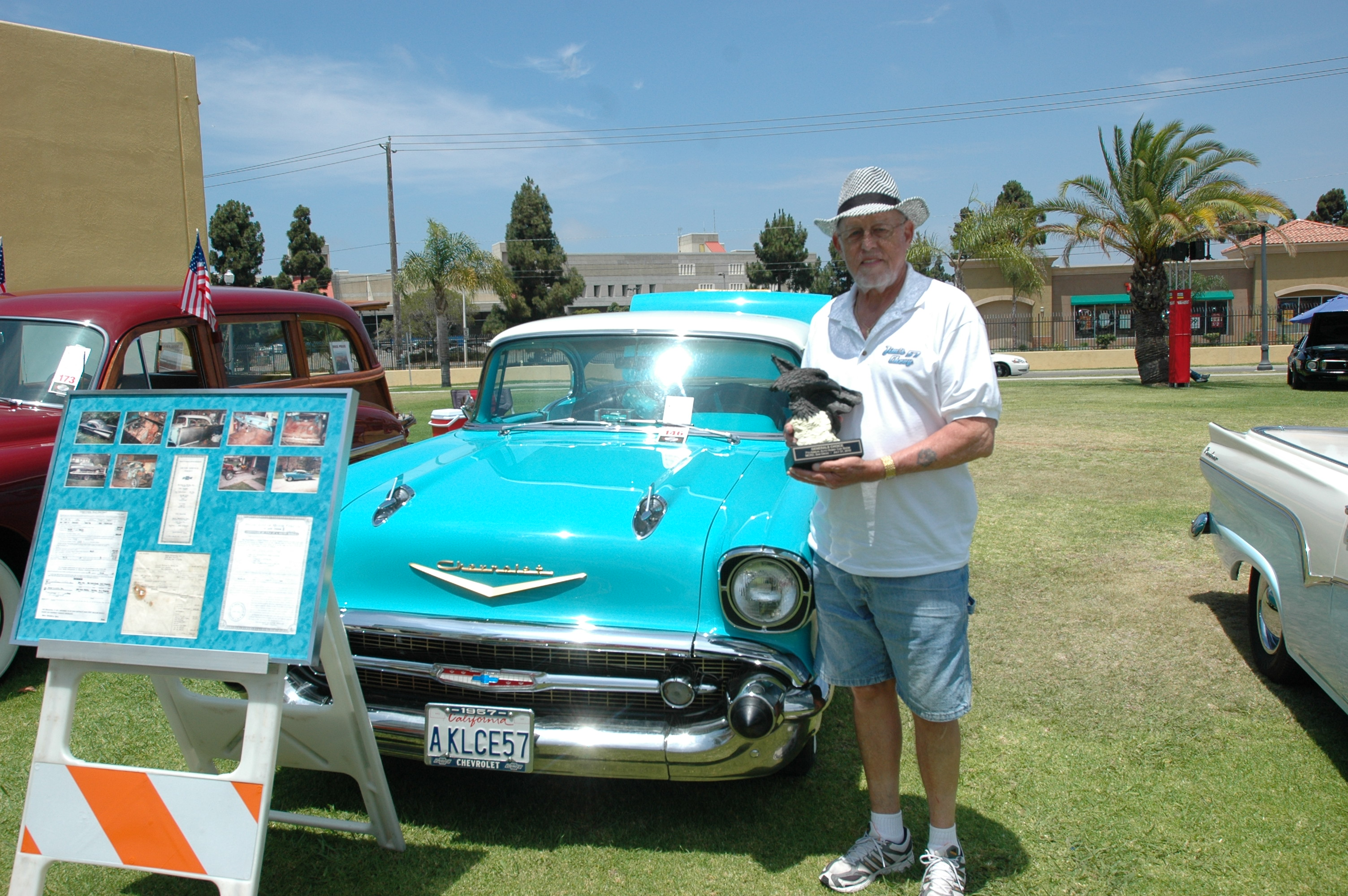Jim Casey of the South Bay Cruisers car club poses with his car, a restored
