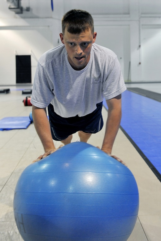OFFUTT AIR FORCE BASE, Neb. -- Tech. Sgt. Jeffrey Strauser, 55th Maintenance Squadron, performs a push-up on an exercise ball during a Boot Camp class at the Offutt Field House May 19. The Boot Camp class is held every Wednesday and Friday from 3:15 to 4:15 p.m. The class consists of circuit training and a combination of high-intensity aerobics, as well as resistance training designed to target fat loss, build muscle and improve heart health. U.S. Air Force Photo by Charles Haymond