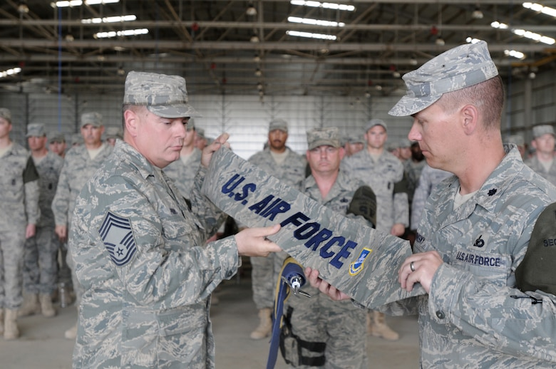 Chief Master Sgt. David Provo and Lt. Col. Theodore Ruminsky case the 506th ESFS squadron guidon for the final time during a transfer of authority ceremony May 28, 2010, at Kirkuk Regional Air Base, Iraq. Members of the 506th ESFS transferred base security to the Army 1st Special Troops Battalion. In addition to the transfer of authority, the 506th ESFS was officially inactivated. Chief Provo is the 506th Expeditionary Security Forces Squadron chief enlisted manager. Colonel Ruminsky is the 506th ESFS commander. (U.S. Air Force photo)
