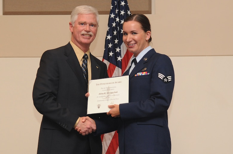 BUCKLEY AIR FORCE BASE, Colo. -- Senior Airman Aleisa Stricharchuk, 566th Intelligence Squadron, receives the William H. Pitsenbarger Award, Airman level, at the Community College of the Air Force Graduation, May 27. The awards are sponsored by the Air Force Association and are competitively awarded to CCAF graduates. (U.S. Air Force photo by Airman 1st Class Manisha Vasquez)